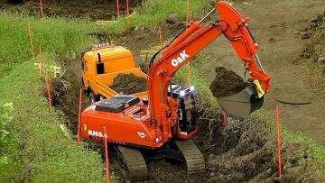 RC LJESTVICA 1:14 MODEL EXCAVATOR O&K RH 6.6 AT WORK CONSTRUCTION SITE / Intermodellbau Dortmund 2016